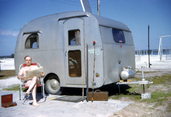 Sitting with travel trailer at St. Petersburg Beach, by The State Library and Archives of Florida